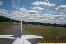 preparing to take off with a glider on tow